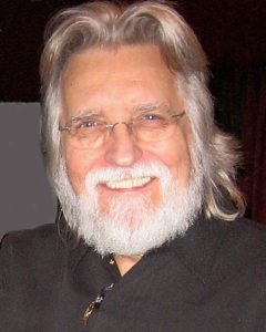 Neale Donald Walsch By Sarah Rozenthuler and Gil Dekel - http://www.poeticmind.co.uk/creative-thoughts/being-at-one-neale-donald-walsch-interview-with-gil-dekel-phd-part-1-of-3, CC BY-SA 3.0, https://commons.wikimedia.org/w/index.php?curid=20023703