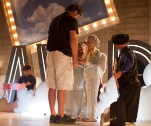 "Brunskill working with 'cherubs' on the  ""It's GAWD!"" set. (photo Eric Ulbrich)"